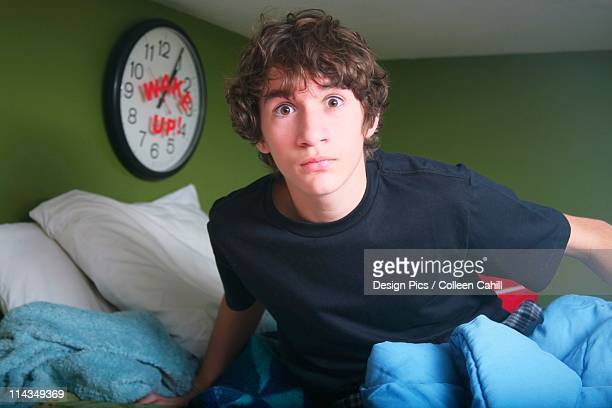 A Teenage Boy Getting Out Of Bed Late