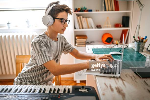 teenage boy having online keyboard lesson - keyboard player stock pictures, royalty-free photos & images