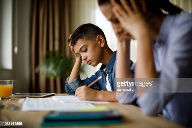 teenage boy having problems in finishing homework - depressed mother stock pictures, royalty-free photos & images