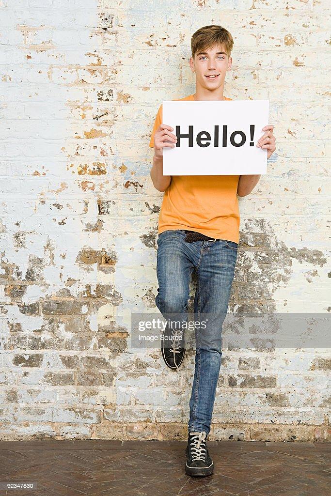 Teenage boy holding sign : Stock Photo