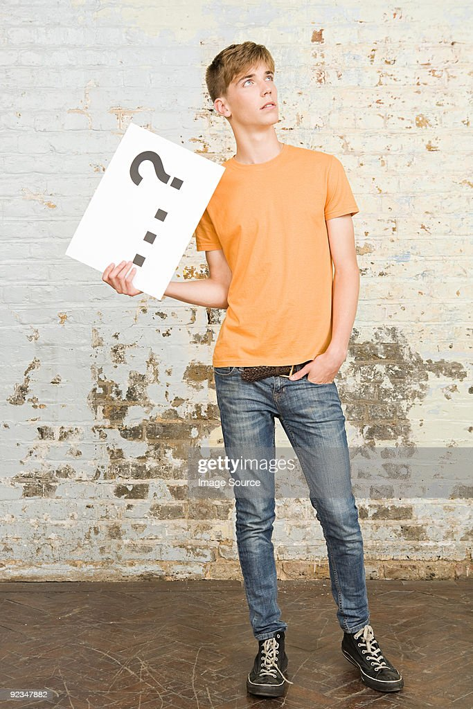 Teenage boy holding sign : Stock Photo