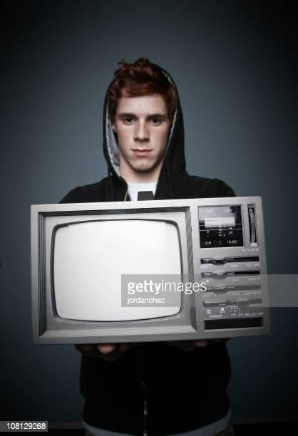 Teenager Boy Holding Fernseher