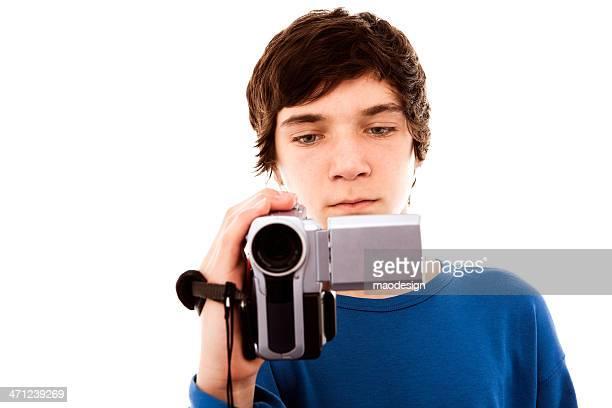 Menino adolescente segurando vídeo Câmera, Close Up Studio Retrato