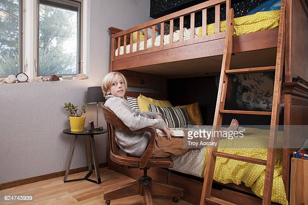 teenage boy in bedroom with book. - tempe arizona stock pictures, royalty-free photos & images