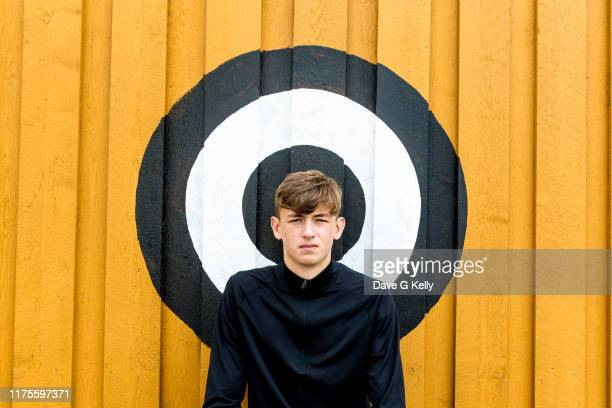 teenage boy in front of a target looking at camera - human head stock pictures, royalty-free photos & images