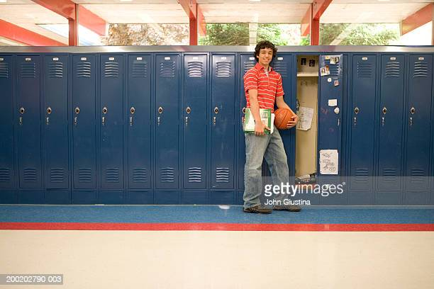 teenage boy (13-15) in front of open locker, portrait - education stock pictures, royalty-free photos & images