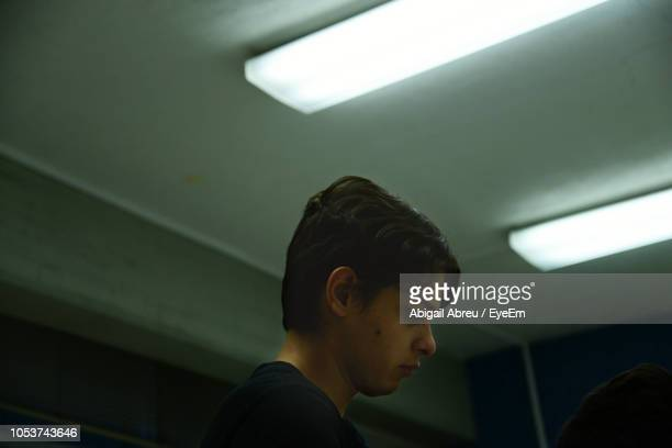 Teenage Boy In Illuminated Room