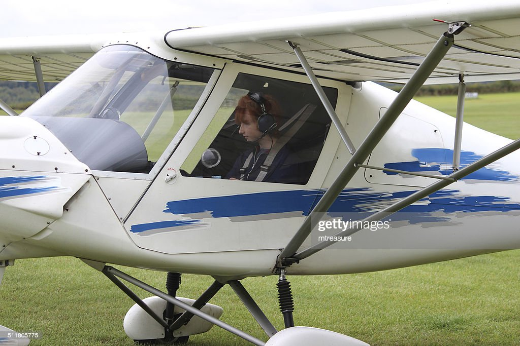 teenage boy in plane cockpit having flying lesson airfield airport