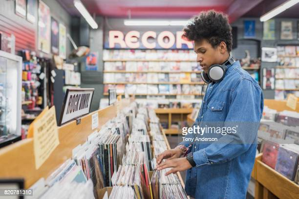 Teenage boy in record store shopping for music