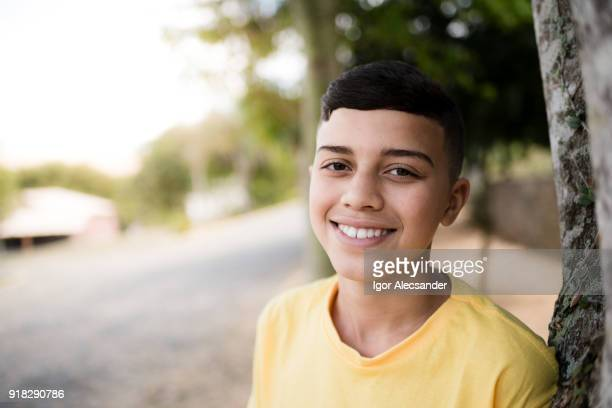 teenage boy in yellow shirt - teenage boys stock pictures, royalty-free photos & images