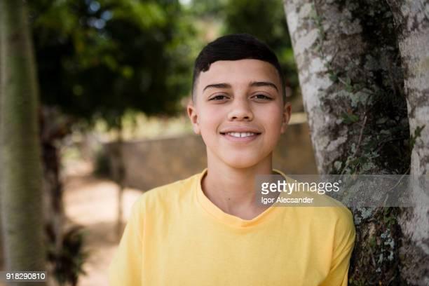 Teenage boy in yellow shirt