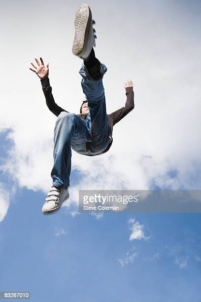 Teenage boy jumping in mid-air