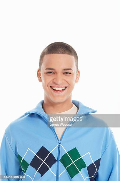 Teenage boy (16-18) laughing, portrait