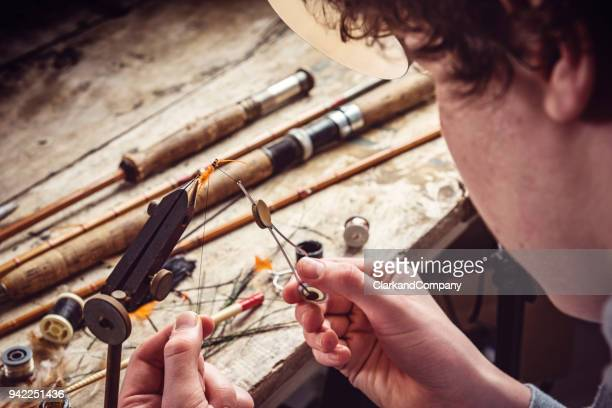 teenage boy learning how to make fishing flies - fly casting stock pictures, royalty-free photos & images