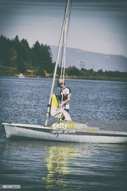 teenage boy learning to sail - sail boom stock pictures, royalty-free photos & images