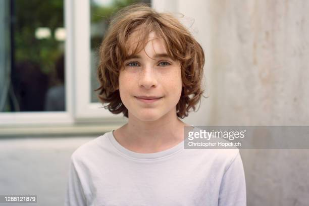 teenage boy looking straight into camera - boys stock pictures, royalty-free photos & images