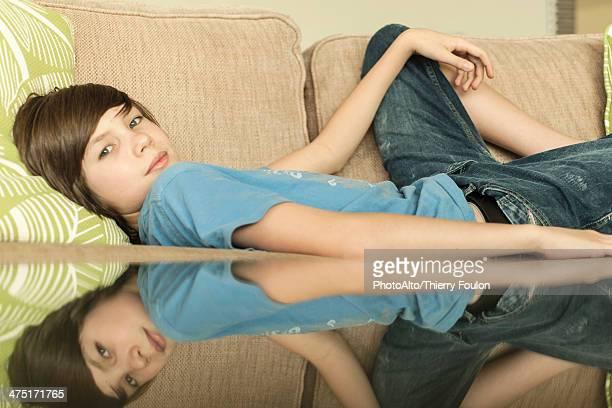Teenage boy lying on sofa, portrait