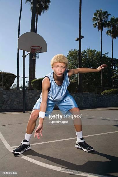 Teenage boy on basketball court