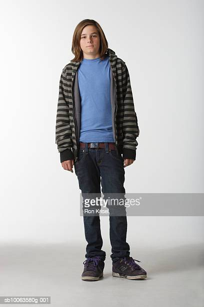 Teenage boy (13-14) on white background, portrait