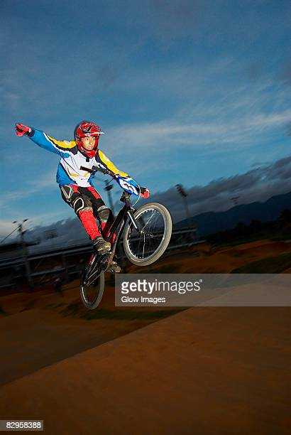 Teenage boy performing a stunt on a bicycle