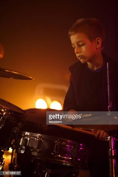 Teenage boy performing at rock concert