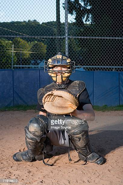 teenage boy playing baseball - baseball catcher stock photos and pictures