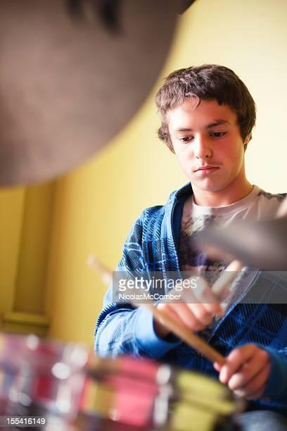 Teenage boy playing drums