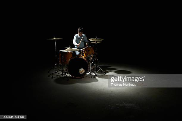 teenage boy (13-15) playing drums - drum kit stock photos and pictures