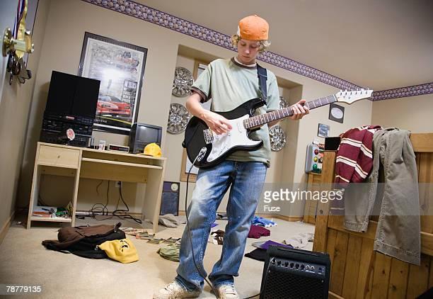 Teenage Boy Playing Guitar