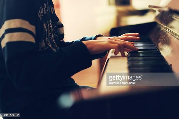 teenage boy playing piano