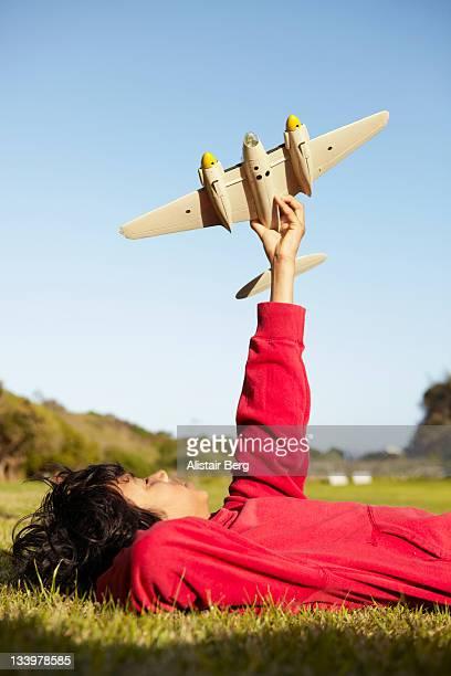 Teenage boy playing with model plane
