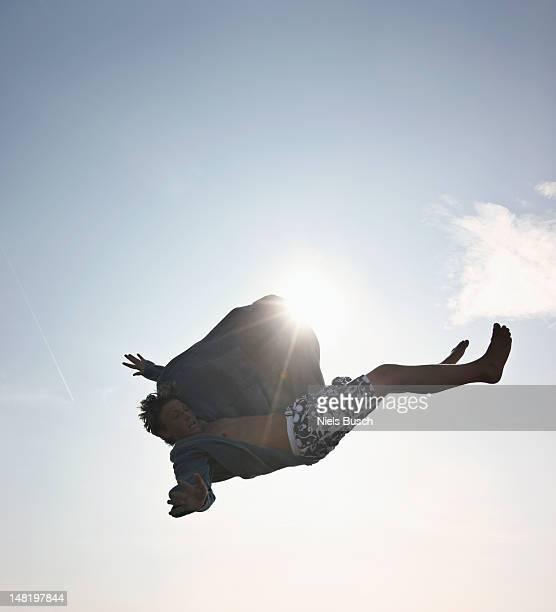 Teenage boy posing in mid-air
