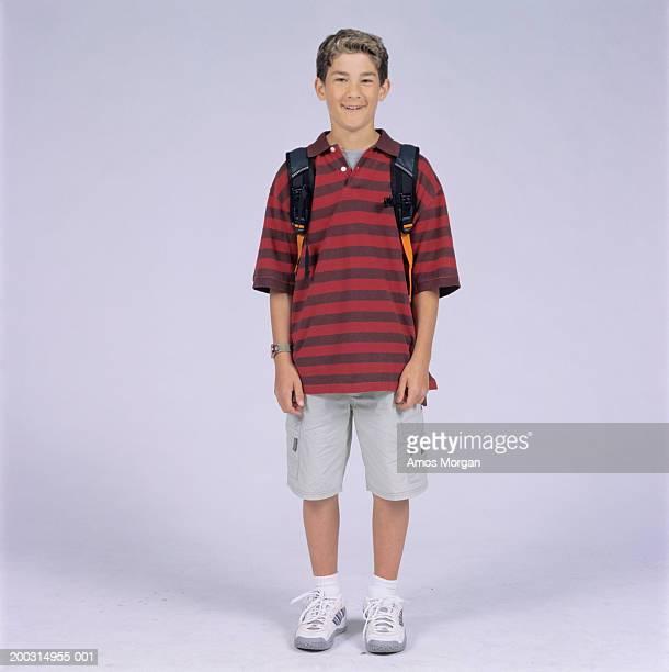 Teenage boy (14-15) posing in studio, portrait