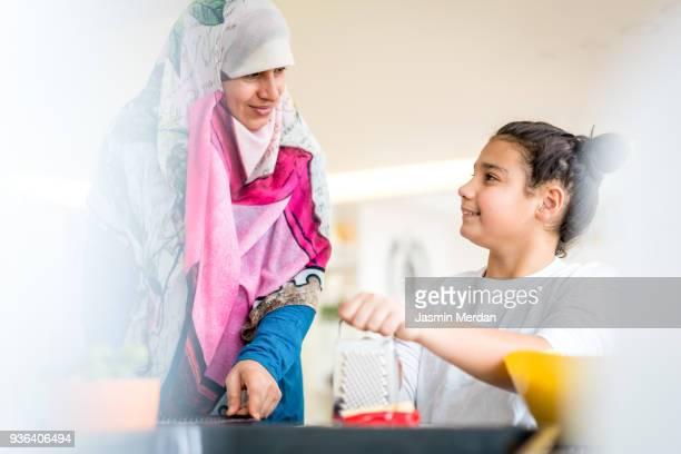 teenage boy preparing food - muslim boy stock photos and pictures