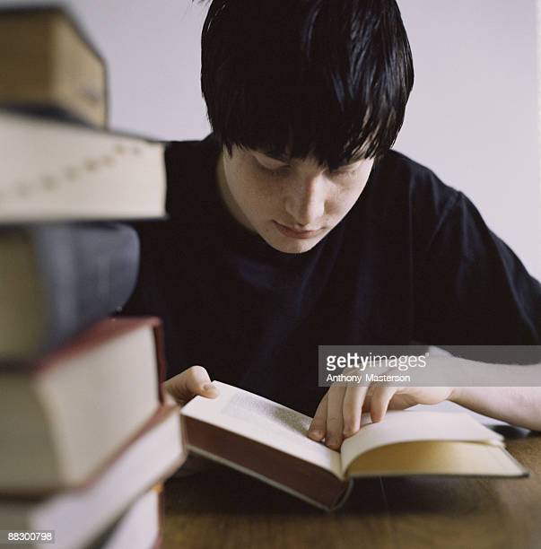Teenage boy reading