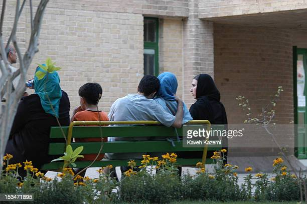 Teenage boy rests his head on his girlfriend's shoulder in a sneaked moment in Shafagh in Tehran, Iran, 4th July 2004. In order not to be noticed,...