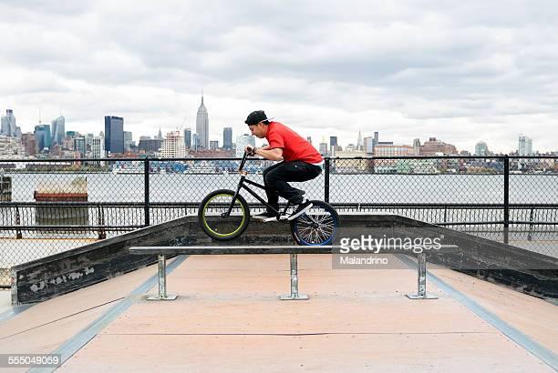 Teenage boy riding a BMX Bike near NYC