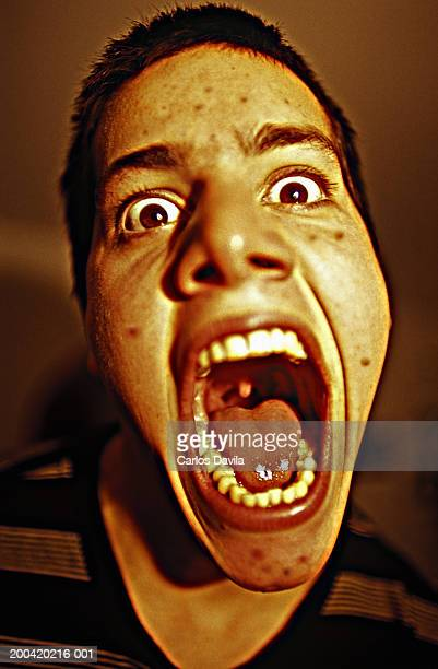 teenage boy (15-17) screaming, close-up - uvula stock photos and pictures