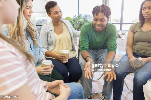 Teenage boy shares with support group
