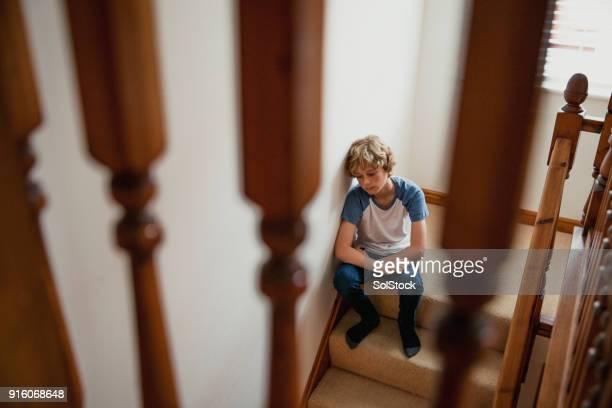 Teenage Boy Sitting on Stairs