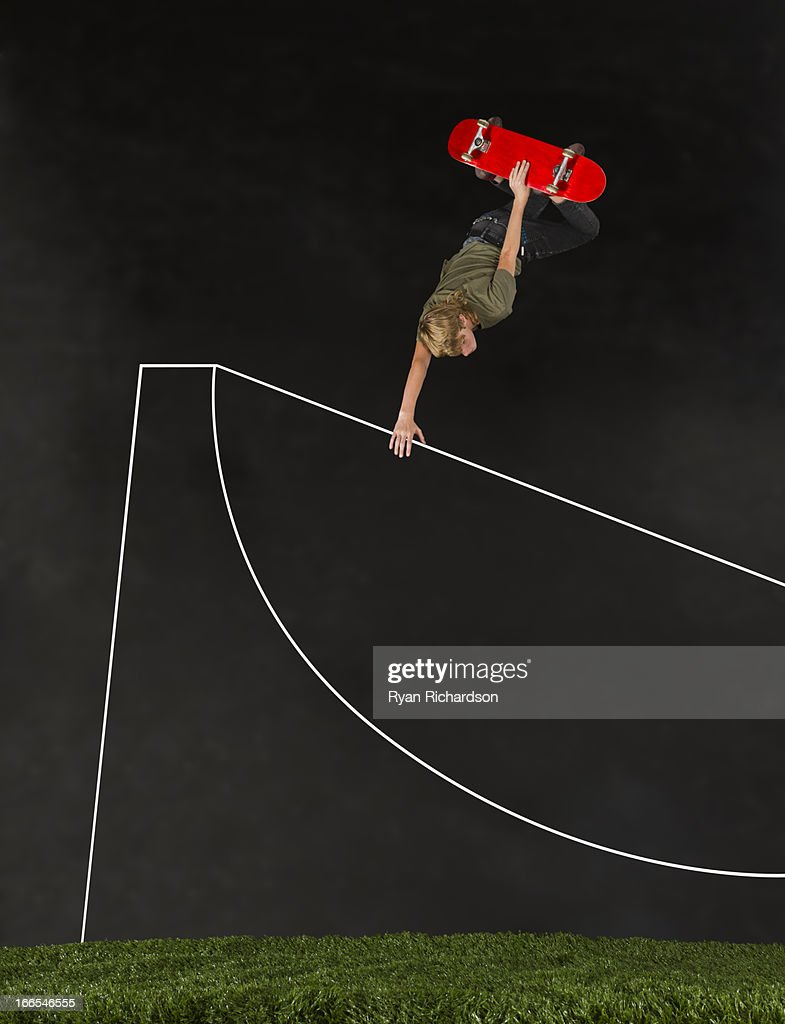 Teenage boy (14-15) skateboarding in half pipe : Bildbanksbilder