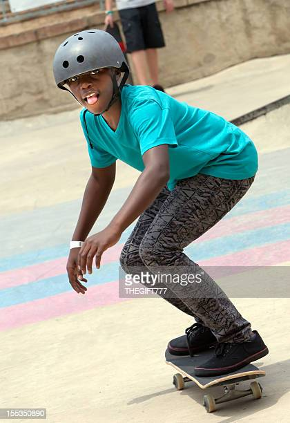 Teenage boy skateboarding on his skateboard