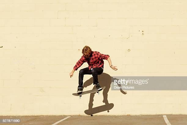 Teenage boy (16-17) skateboarding
