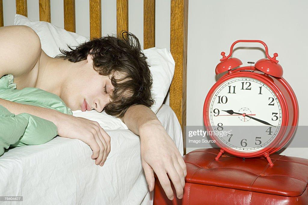 Teenage boy sleeping : Stock Photo