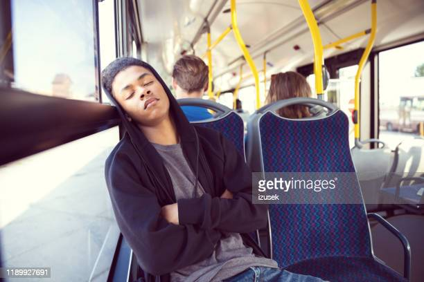 teenage boy sleeping while traveling in bus - izusek stock pictures, royalty-free photos & images