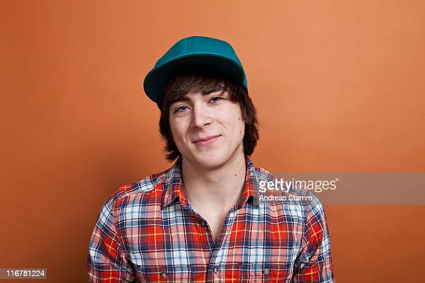 A teenage boy smiling, portrait, studio shot