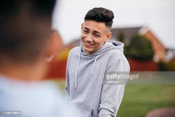 teenage boy socialising with friends - one teenage boy only stock pictures, royalty-free photos & images
