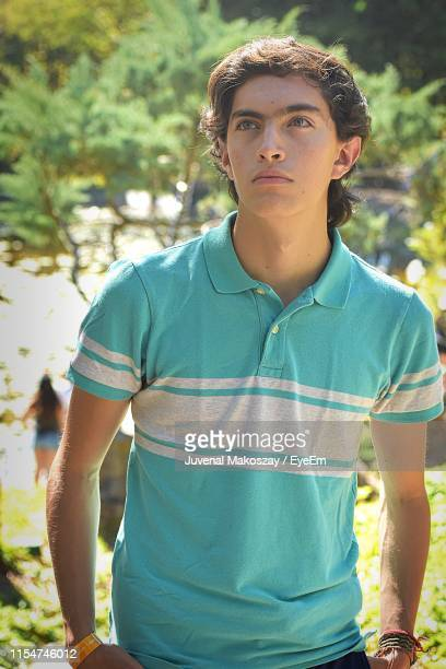 Teenage Boy Standing Outdoors