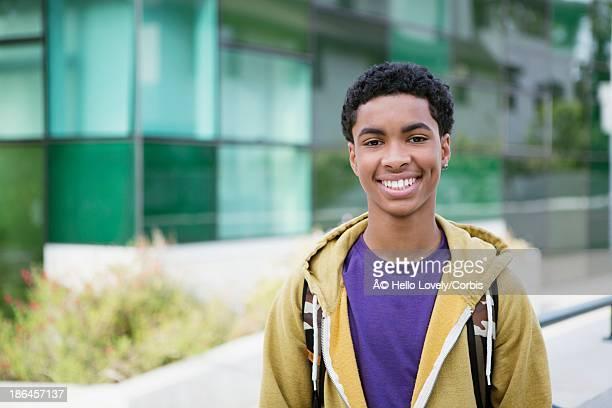 Teenage boy (13-15) standing outside