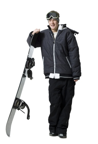 Teenage boy standing with snowboard and goggles - gettyimageskorea